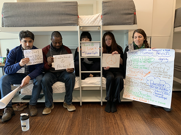 Students protest during humanitarian simulation